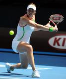 http://img284.imagevenue.com/loc220/th_80367_andrea_petkovic_australian_open_2011_43_122_220lo.jpg
